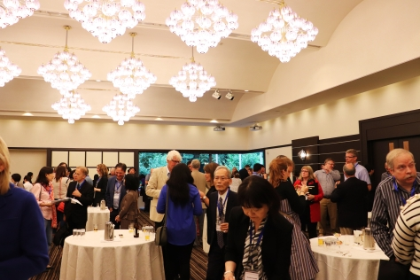 Conference attendees mingle over food and drinks at the opening reception. Photo credit: Yu Kominami