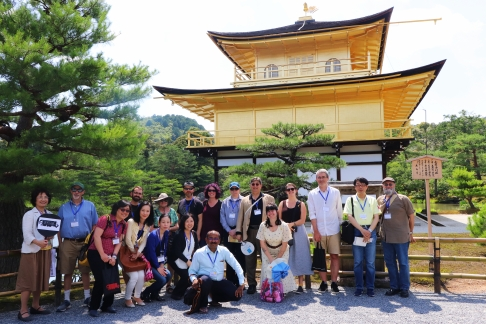 Attendees pose for a photo in front of the Kinkakuji Golden Pavilion temple, one of the most popular destinations in Kyoto. Photo credit: Yu Kominami