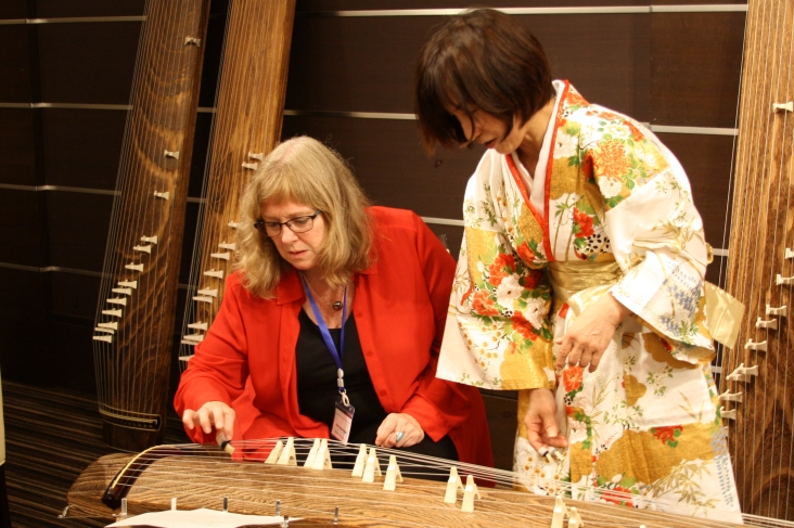 After receiving some instruction, Jana Argersinger tries her hand at playing the koto. Photo credit: Kyosuke Ogawa