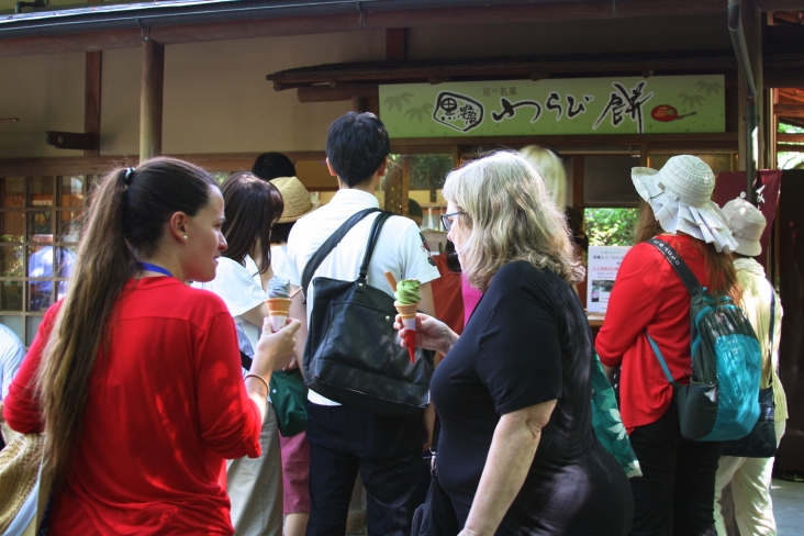 Many attendees enjoy green tea ice cream (among other flavors) to cool off after a long sightseeing walk in the summer heat. Photo credit: Kyosuke Ogawa